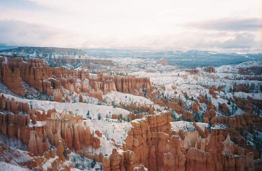Snowy red Utah sandstone pillars