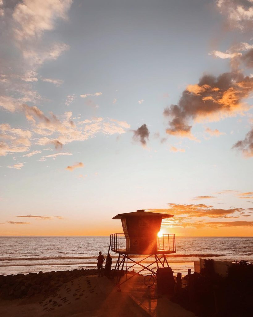 Sunset over the beach life guard tower
