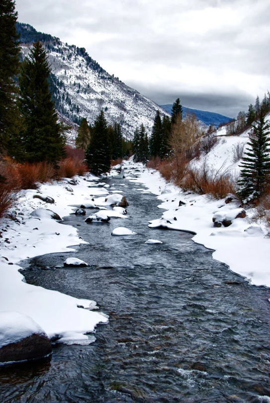 Beaver Creek colorado stream in snowy mountains