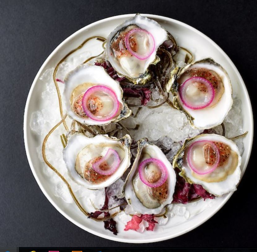 Prepared iced oysters garnished with onion