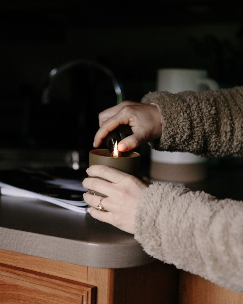 Lighting a candle on a cold winter day