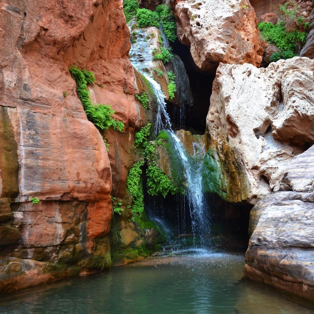 Serene canyon waterfall and pool