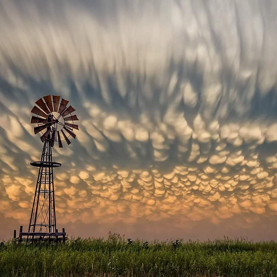 Cloud at sunset against windmill