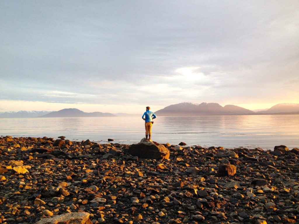 Standing on a rocky alaskan beach