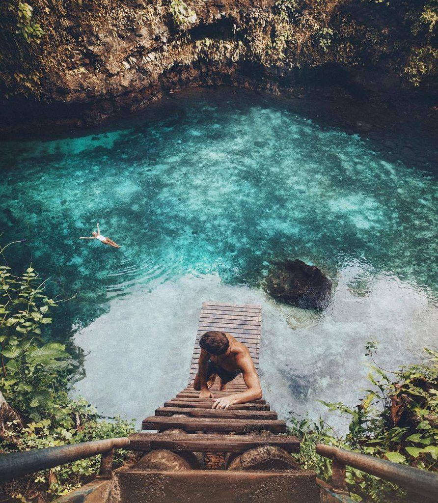 Climbing a ladder over blue water