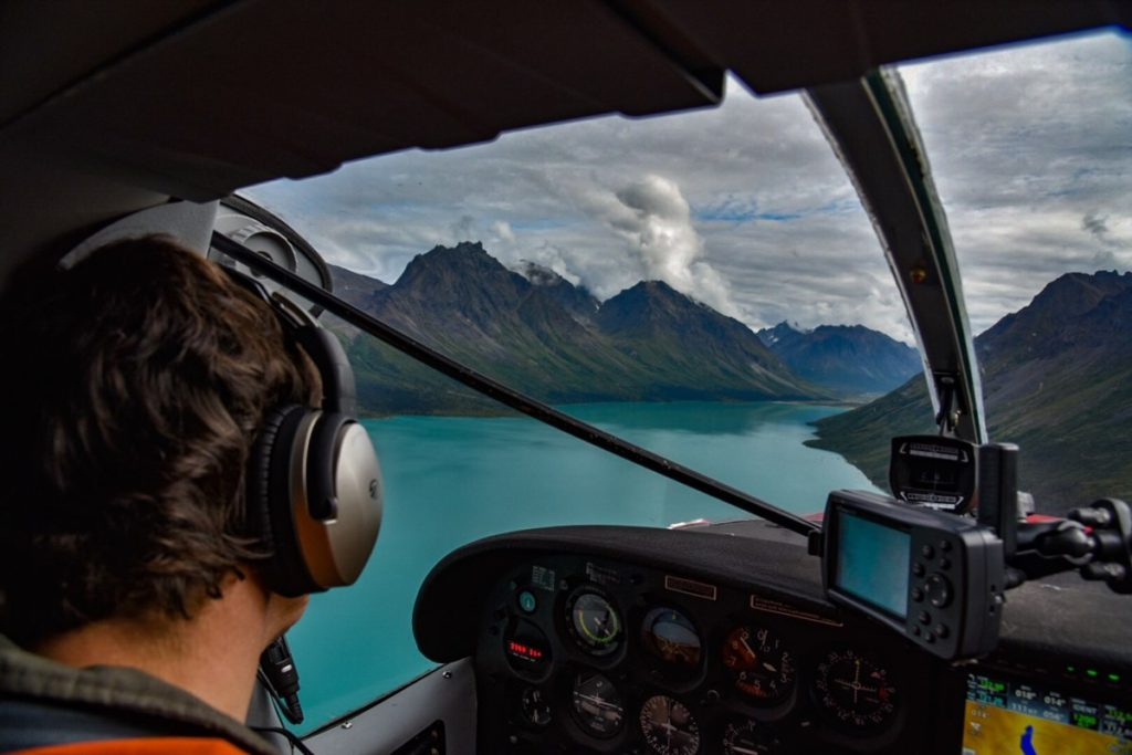 Flying a plane over mountain lake