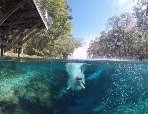 Jumping into clear blue water