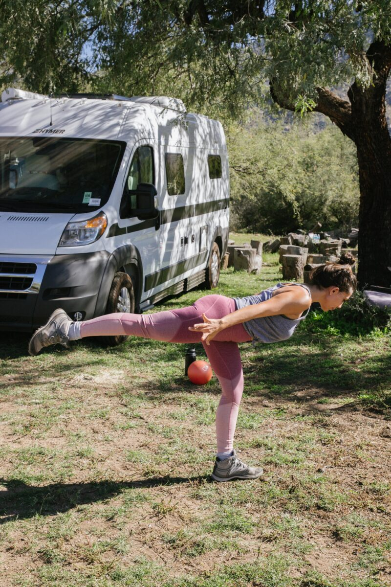 How to workout on the road this New Years. Warrior II pose